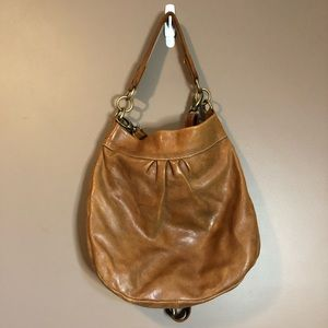 Roots brown leather purse. Dual straps and come with dust bag